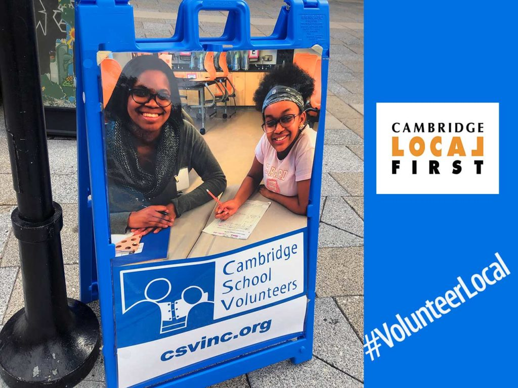 sidewalk A-frame sign featuring a young professional woman and her student tutee